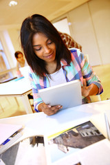 Student girl using electronic tablet at school