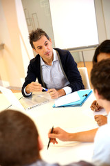 Teacher giving business presentation to students