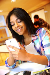 Student girl using smartphone in class