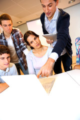 Group of students in computer training with teacher