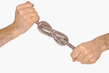 Iron knot in man's hands