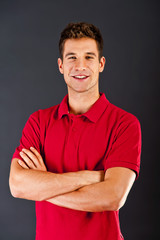 Man on black background in red shirt