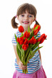 little girl with bunch of red tulips - mothers day concept