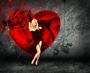 Woman with Splashing Heart on Dark Background