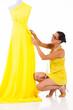 female dressmaker working on a dress