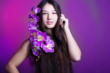 young beautiful girl with long hair and orchid