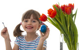 happy little girl coloring easter eggs