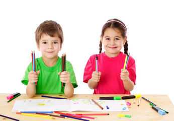 Two little kids with color pencils