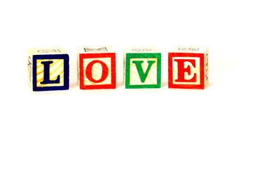 Love, colourful letters printed on wooden blocks