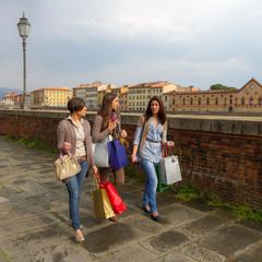Beautiful Young Women Walking in the City with Shopping Bags