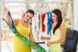 fashion designer showing a dress to her customer