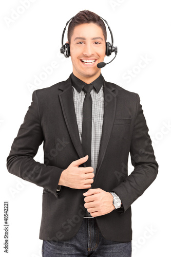 A handsome male customer service operator wearing a headphones a