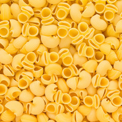 Italian Pipe Rigate Macaroni Pasta raw food background or textur