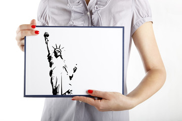 Woman holding New York with the Statue of Liberty