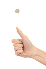 Woman hand tossing a coin