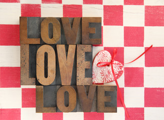 love words with heart on checked background