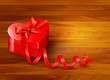 Holiday background with gift red box and red ribbon. Vector illu