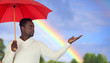 Attractive african man with a red umbrella