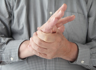 man with numbness in hand
