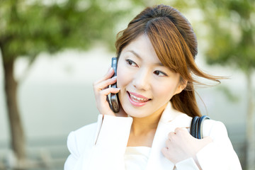 Beautiful asian businesswoman in the town