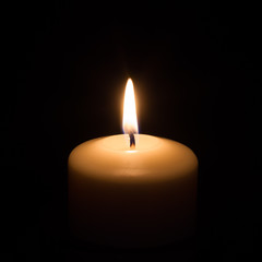 Candle on black background