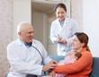 Positive pediatrician doctors examining little baby