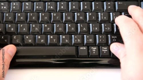 Male hands typing smth on a computer keyboard