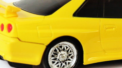 yellow toy radio-controlled car moves back and forth