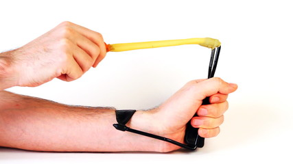 hands man pull elastic band of slingshot and shoot, on white