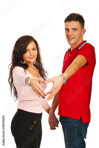 Loving young couple with heart shape