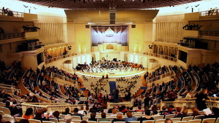 people waiting for concert in hall