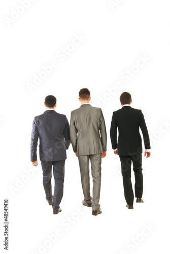Back of business men walking
