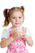 kid girl drinking yogurt or kefir over white