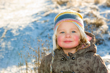 child in front of winter- background