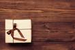 Vintage gift over wooden background