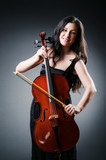 Woman cellist performing with cello