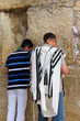 Jewish worshipers pray at the Wailing Wall. Jerusalem, Israel.
