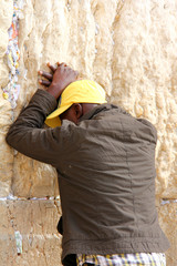 Jewish worshiper pray at the Wailing Wall . Jerusalem, Israel.