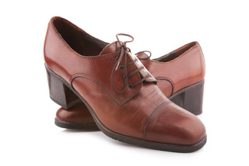 Vintage female shoes isolated on white