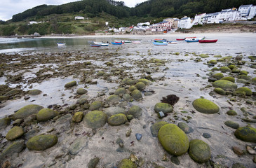 Low tide, beach and boats in Bares, Galicia, Spain.