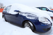 Car covered by heavy snow in winter time