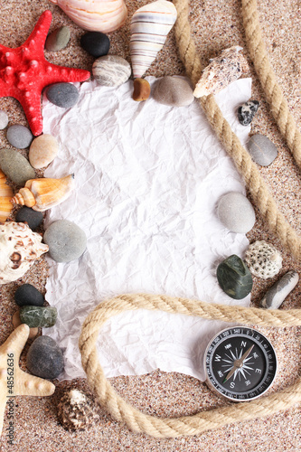 Blank paper on sand beach with seashells and starfishes