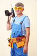 Builder with drill on wall background