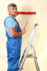 Builder measuring wall in room close-up