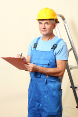Builder enters into contract on work on wall background