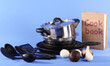 composition of kitchen tools and cook book on blue background