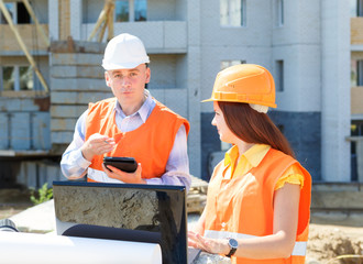 female and male construction workers