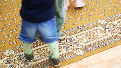 feet of kids walking in circle each other at kindergarten