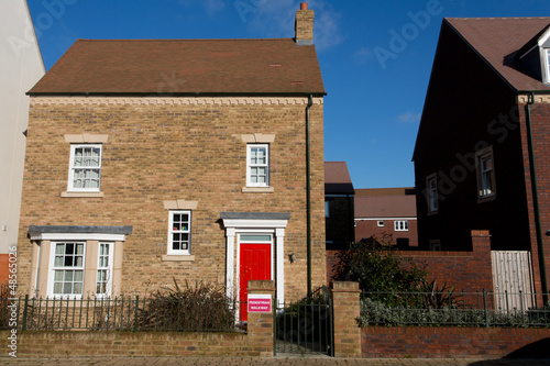New detached house with red door