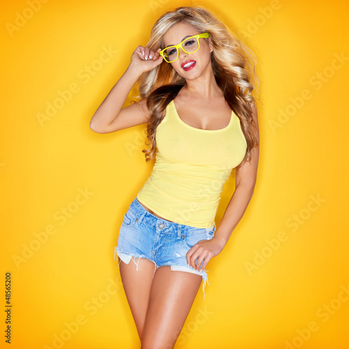 Young Woman In Yellow Tanktop And Eye Glasses